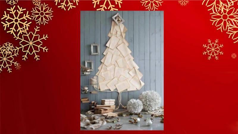 Delicado árbol navideño de pared con hojas de papel